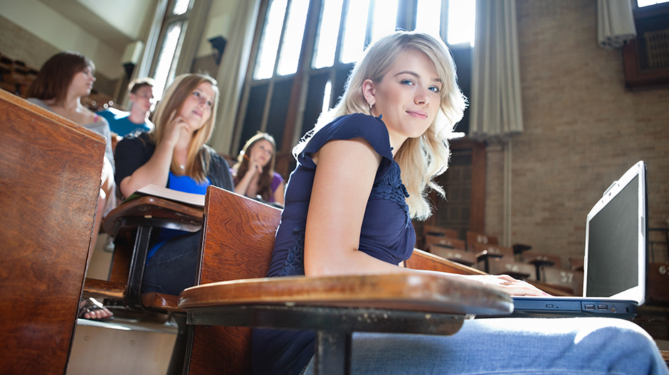 Attractive young woman in lecture hall